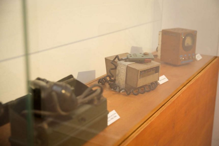 From left) A telephone set box, radio transmitter and current supply regulator on display at the bunker's exhibition.