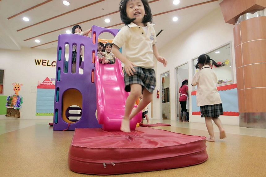 Pre-schoolers having fun in the indoor play area of Just Kids Learning Place childcare centre in Yishun.