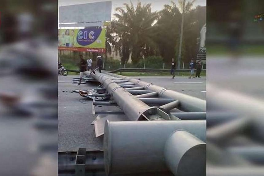 A metal signboard crashed into a car, ripping off its roof and killing three in the vehicle on Oct 10. The accident happened when a trailer heading towards Ipoh rammed into the rear-end of a lorry before losing control. It then hurtled into a metal p