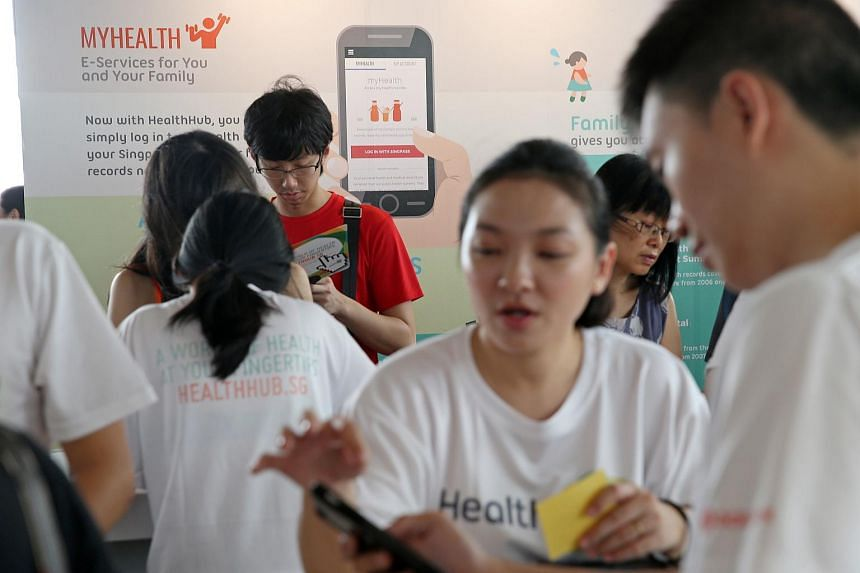 Health Promotion Board staff guide members of the public in downloading and using the new app, which was launched by Health Minister Gan Kim Yong on Oct 18, 2015.