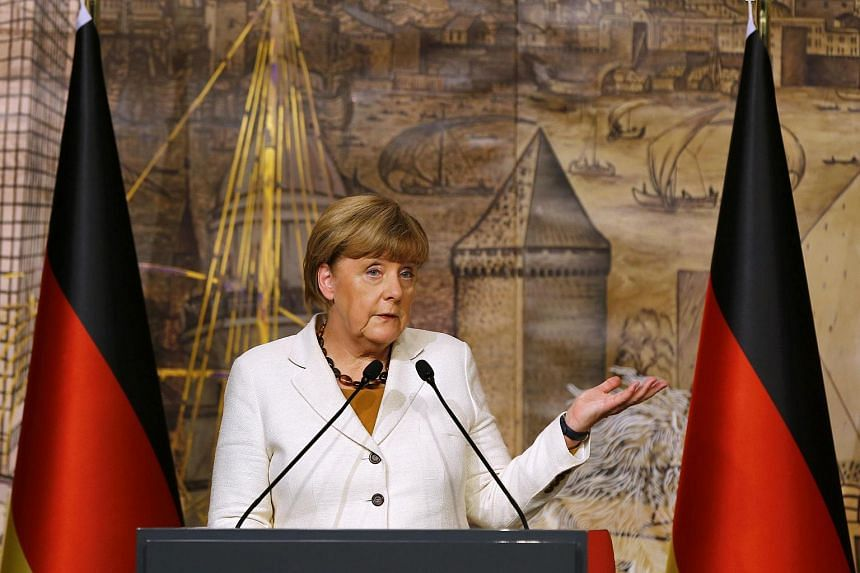 German Chancellor Angela Merkel speaks during a joint news conference with Turkish Prime Minister Ahmet Davutoglu in Istanbul, Turkey on Oct 18, 2015.