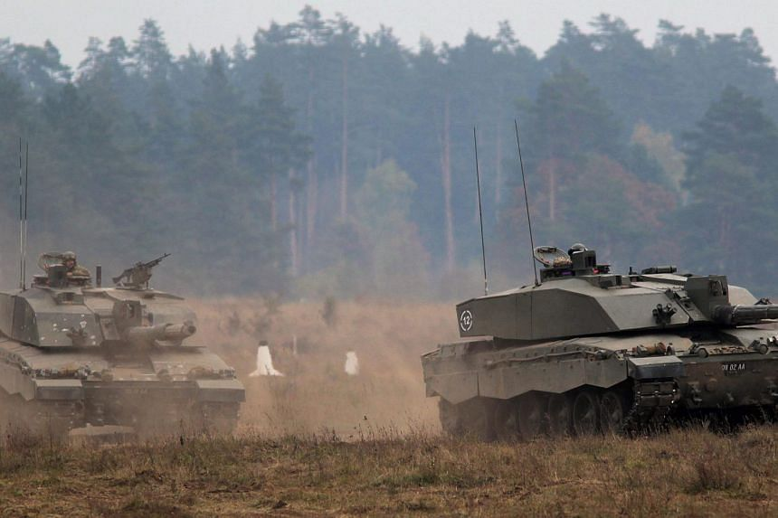 British Army FV4034 Challenger 2 battle tanks are seen during the North Atlantic Treaty Organisation Nato military exercise at the Land Forces Training Centre.