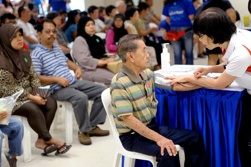 Mr Chong Ming Kwang having his blood pressure checked at the Jurong Medical Centre on Aug 22, 2012.