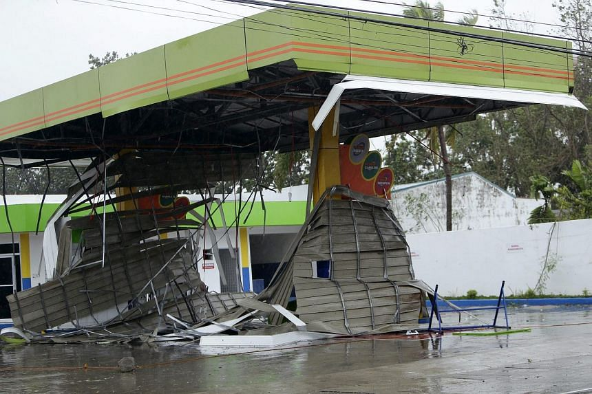 A damaged gasoline station in the town of Munoz, Philippines, on Oct 18 2015.