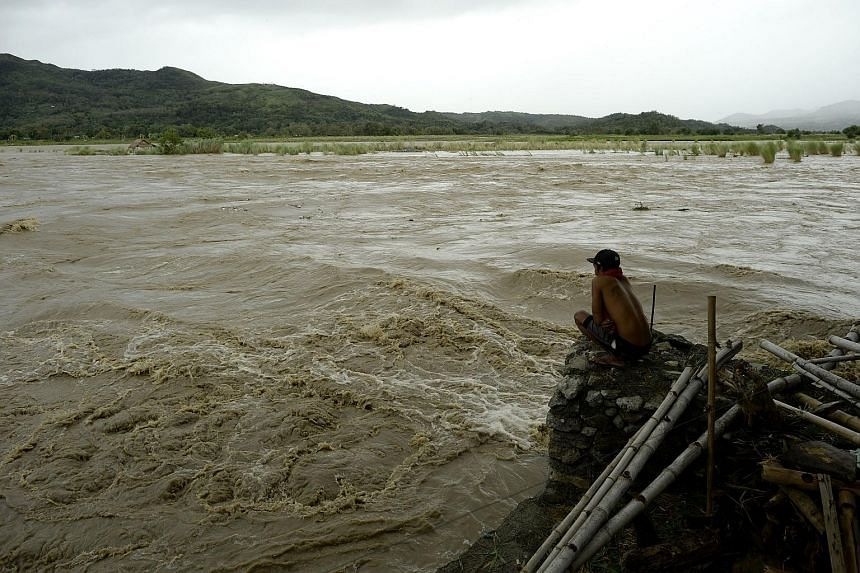 A man looks at the rising water level of the Magat River caused by continuous rains of Typhoon Koppu at Bayombong, Philippines, on Oct 18, 2015.