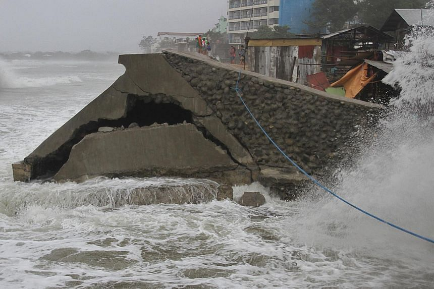A damaged seawall, caused by strong waves brought by typhoon Koppu, is seen in Ilocanos Norte town, Philippines, on Oct 18, 2015.