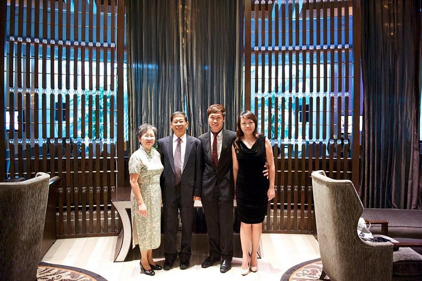 Forum contributor Phillip Tan Fong Lip with his wife Winnie, son Avin and daughter-in-law Arielle. Mr Tan says he writes to the Forum to hone his mental faculties.