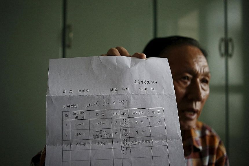 Mr Ahn Yoon Joon - one of 90 South Korean participants at this week's reunion - holds a confirmation document of the whereabouts of his family members living in North Korea. He is set to meet his two younger sisters, whom he has not heard from in mor