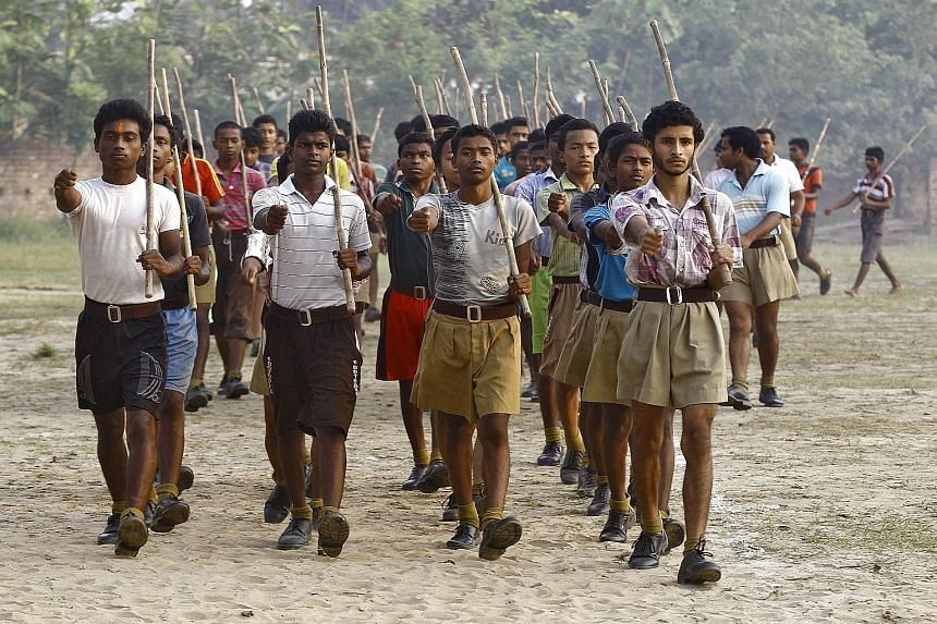 Volunteers of the RSS marching during a training session in Tatiberia village in West Bengal. The RSS, which describes itself as a cultural and social group, is India's most powerful Hindu organisation.