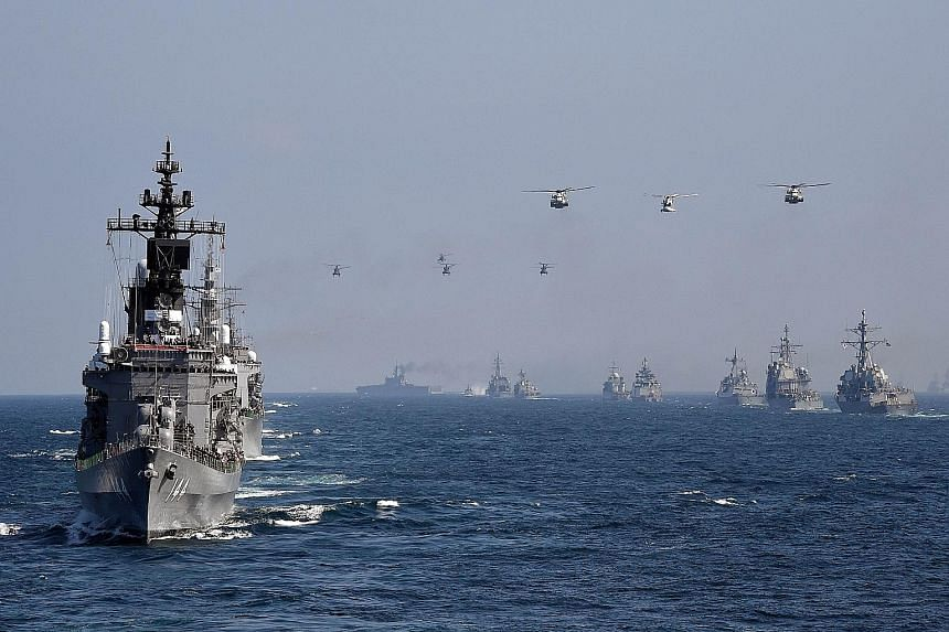 An escort ship from Japan's Maritime Self-Defence Force taking part in a fleet review off Kanagawa prefecture yesterday. Vessels from India, South Korea, Australia, France and the United States also participated.