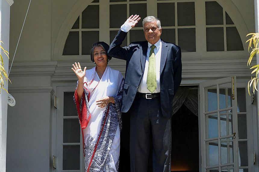 Sri Lankan PM Ranil Wickremesinghe and his wife Maithree in Colombo in August. His predecessor, Mr Mahinda Rajapaksa, had angered India by moving closer to China, and last year's submarine halts by the Chinese navy were seen as a tipping point in the