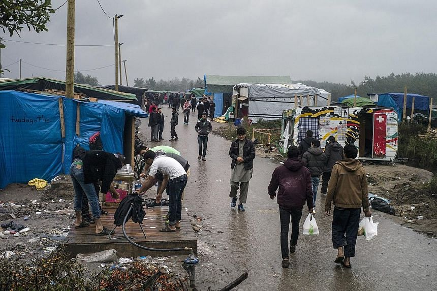 The makeshift migrant camp on the outskirts of Calais, France, where up to 6,000 migrants live in crude shelters made of wood and salvaged material which offer little protection from the creeping cold. Volunteer groups fear that conditions in the cam