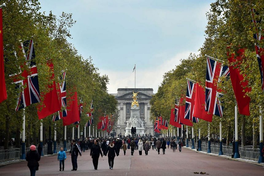 British and Chinese flags fly on the Mall in central London on Oct 18, 2015.