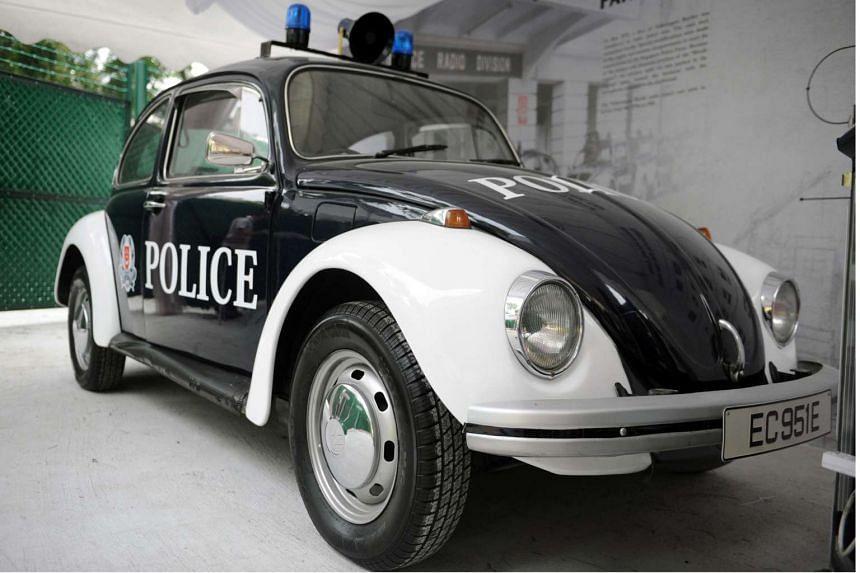 A vintage police car on display in the secret police bunker.