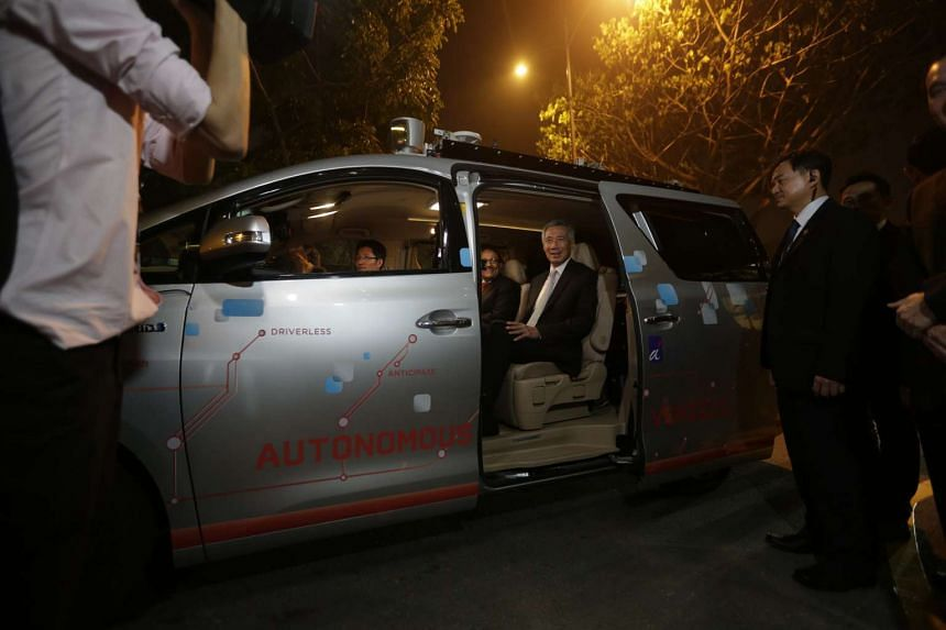 Prime Minister Lee Hsien Loong takes his seat in an autonomous vehicle at the official opening ceremony for Fusionopolis Two on Oct 19, 2015.