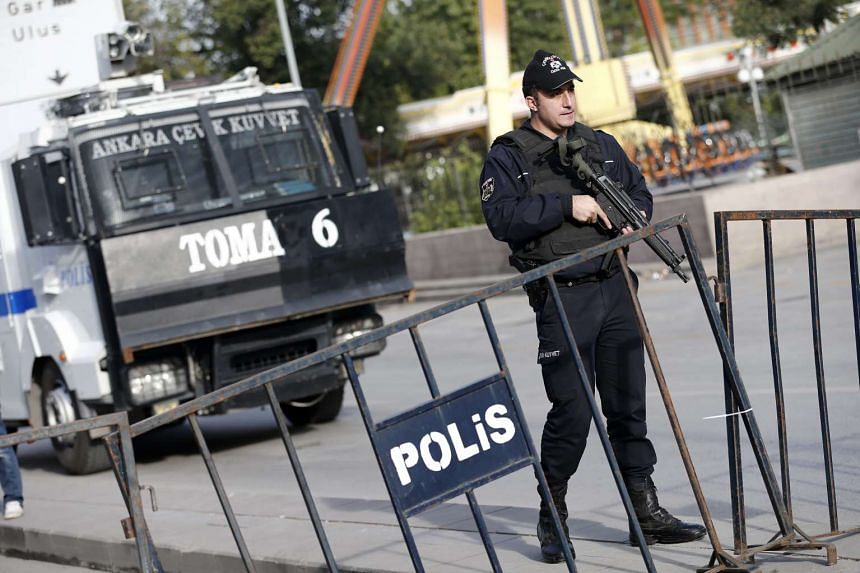 Turkish police officers securing the area one day after a double suicide bombing, in Ankara, Turkey,  on Oct 11, 2015.