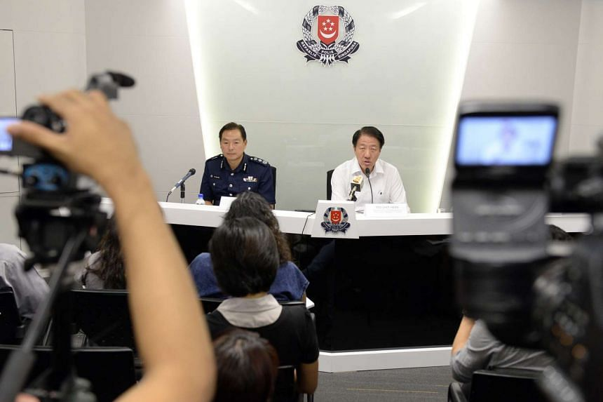 Deputy Prime Minister Teo Chee Hean (right) and Commissioner of Police Ng Joo Hee at a press conference announcing the capture of Kovan double murder suspect Iskandar Rahmat on July 13, 2013.