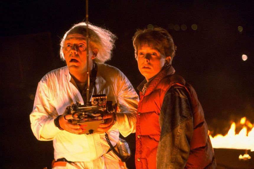 Dr Emmett Brown, played by Christopher Lloyd (right), and Michael J. Fox as Marty McFly look Back to the Future in a scene from the original film.