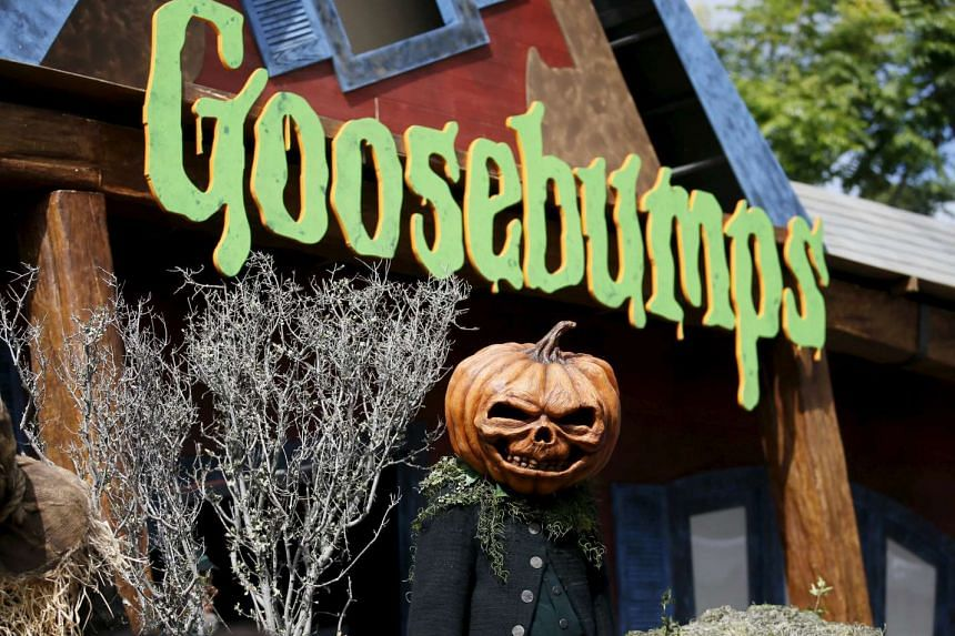 A person dressed as a pumpkin monster poses at the premiere of the film Goosebumps, in Los Angeles,