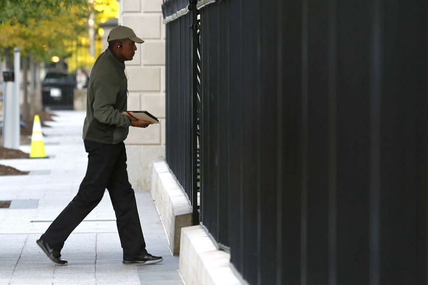 US President Barack Obama walks into the White House in Washington, after playing golf at TPC Potomac at Avenel Farm in Maryland on Saturday..