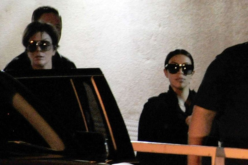 Television personalities Kris Jenner (left) and Kim Kardashian leave Sunrise Hospital & Medical Center where former NBA player Lamar Odom is being treated in Las Vegas, Nevada.