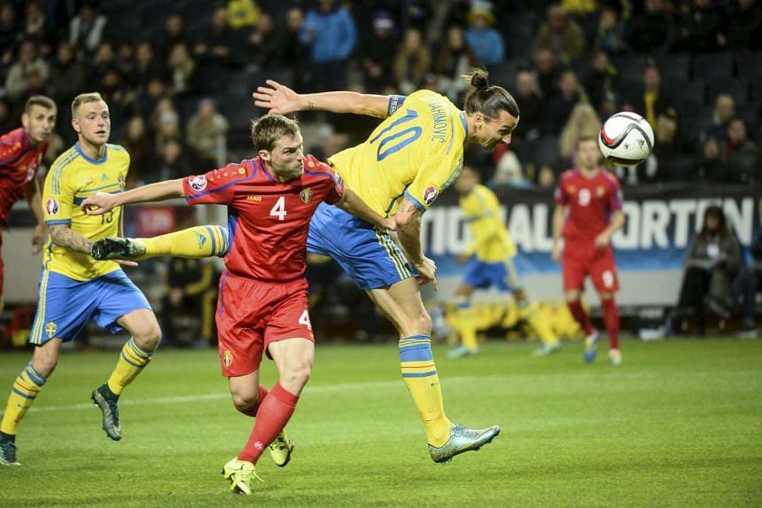 Sweden's Zlatan Ibrahimovic (10) heads the ball past Moldova's Iulian Erhan during their Euro 2016 group G qualifying football match.