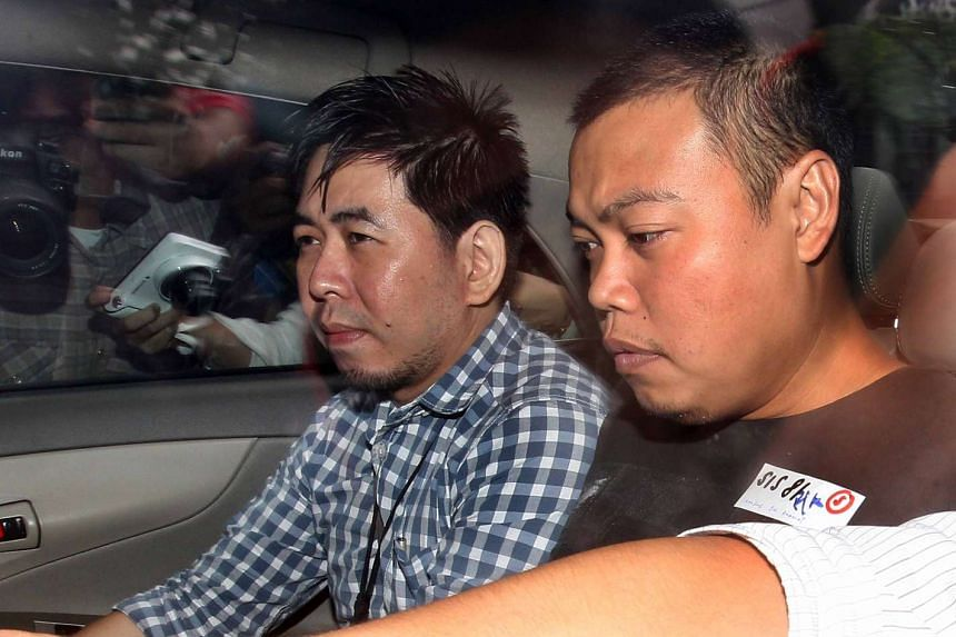 Iskandar Rahmat (right) was arrested in Johor Baru two days after the alleged murders. He faces the death penalty if convicted.