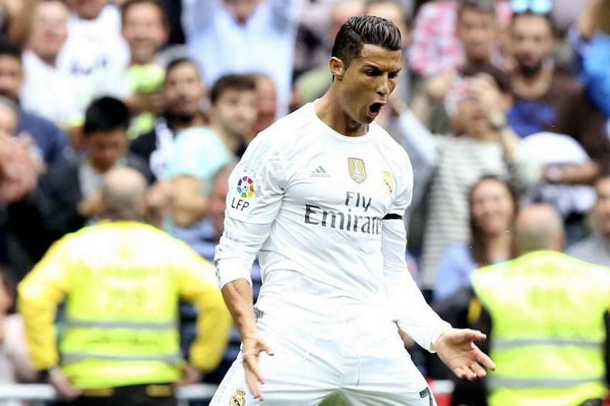 Real's Portuguese star Cristiano Ronaldo celebrating after putting them 2-0 up against Levante. His 324th goal for the club edged him ahead of club legend Raul.