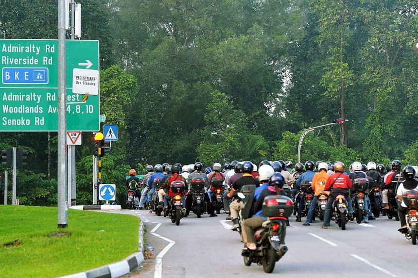 Malaysian-registered motorcycles leaving the Woodlands Checkpoint on the way to their workplaces.