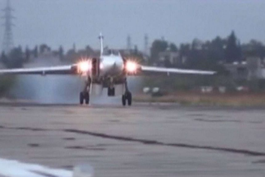 A Russian Sukhoi Su-24M military aircraft is seen landing on the tarmac at Hmeymim air base near Latakia, Syria, in this image released on Oct 15, 2015.