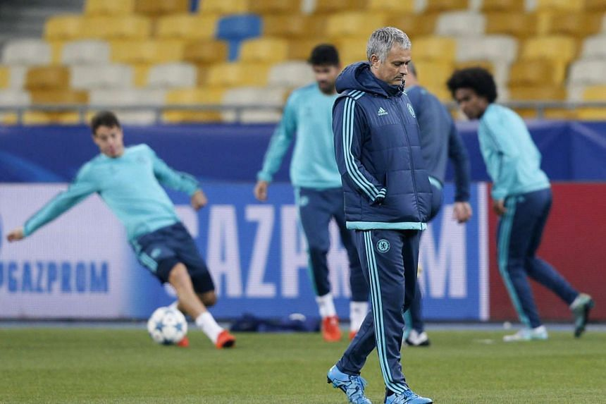 Chelsea manager Jose Mourinho (centre) during a training session of his team in Kiev, Ukraine, 19 Oct 2015.