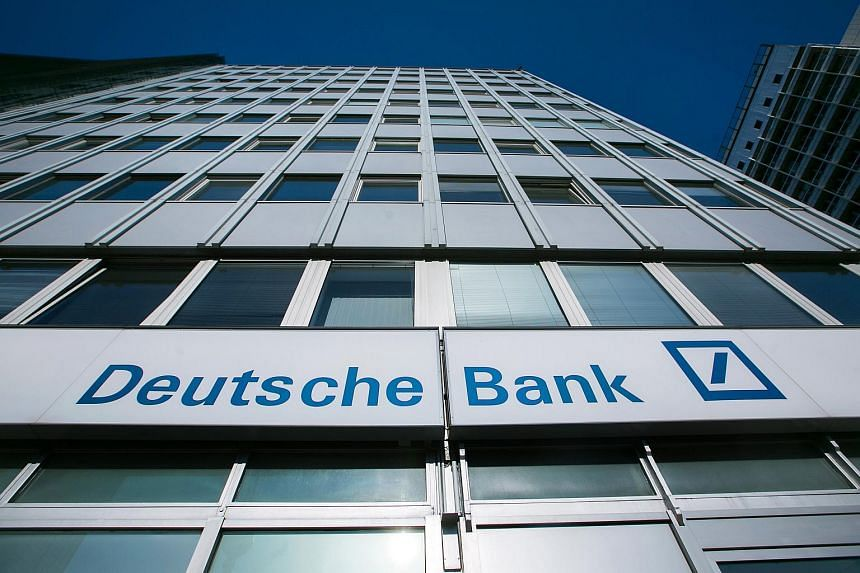 The logo of Deutsche Bank AG on the exterior of a bank branch in Berlin, Germany.