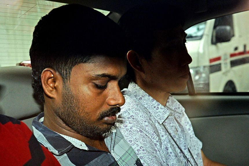 Thiruppathi Veerapperumal being taken to the State Courts on Aug 27, 2014.