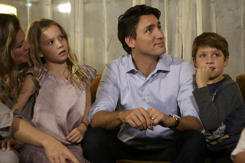 Liberal leader Justin Trudeau (centre) with his wife Sophie Gregoire, daughter Ella Grace and son Xavier (right) as he watches the results of Canada's elections in Montreal on Oct 19.