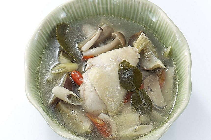 Clear tom yam soup with chicken leg