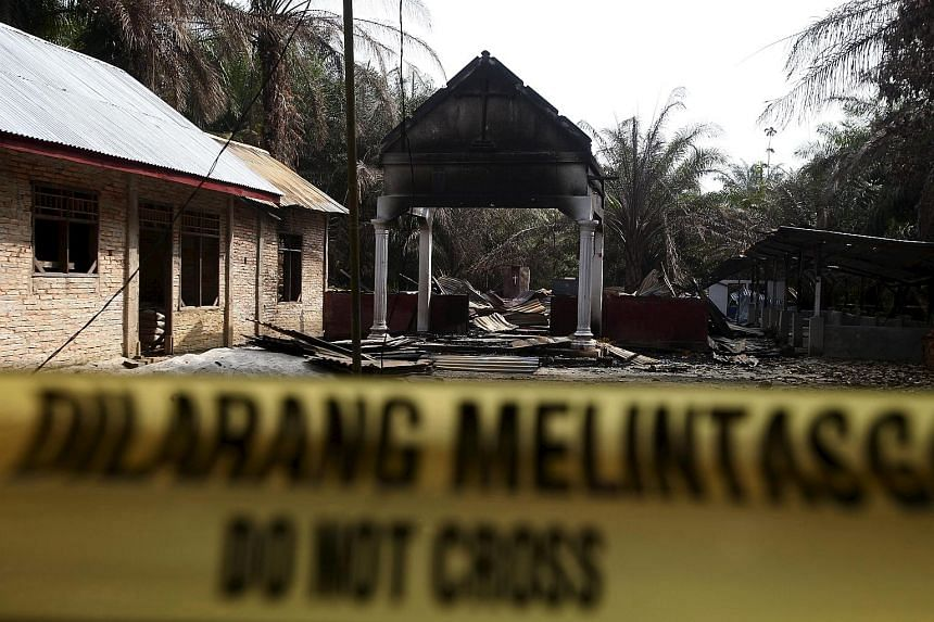 Police tape barring access to a burned church in a village in Aceh Singkil, Indonesia, last week. A mob burned down the church, leaving one person dead and forcing thousands of Christians to flee the area. Aceh is the only province in Indonesia with