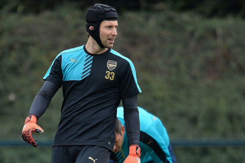 Arsenal's Czech goalkeeper Petr Cech in training at their London Colney training ground in Hertfordshire yesterday. He was surprisingly dropped for their previous Champions League outing against Olympiakos but looks set to start today with David Ospi