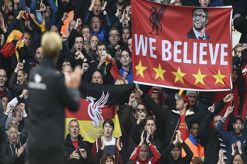 New manager Juergen Klopp and the Liverpool faithful applauding after the 0-0 draw at Spurs. Fans must not expect too much, too soon of the German.