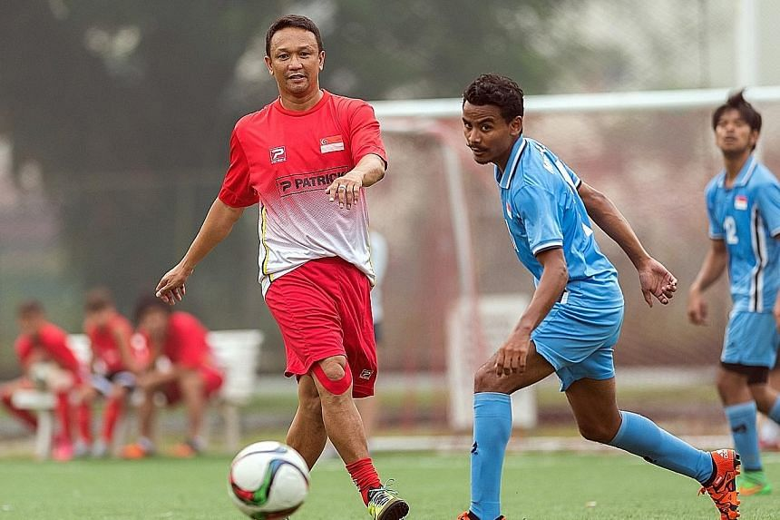 Legendary Lion Fandi Ahmad (left), playing for the ex-internationals against the S'pore Cerebral Palsy football team. The Asean Para Games are from Dec 3 to 9.