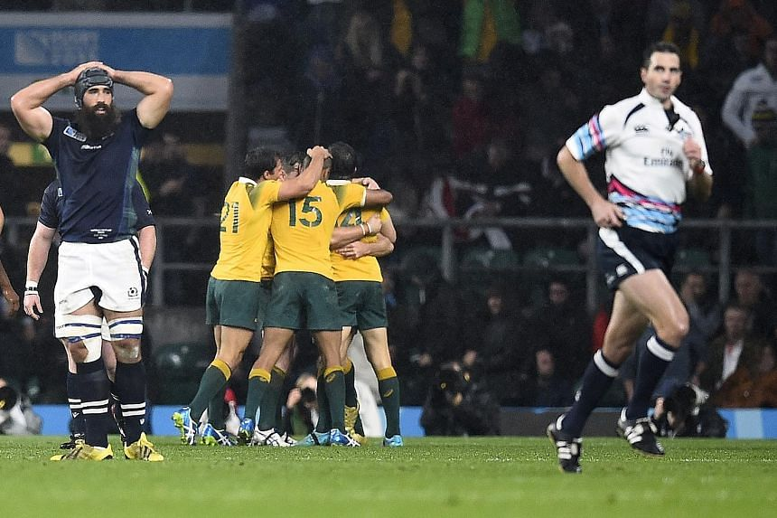 THE MAN IN THE MIDDLE (far right): Australia players celebrating their win as referee Craig Joubert dashes off the field at the end of the game. THE INCIDENT (below): The ball ricochets as (from left) Australia prop Greg Holmes, Scotland flanker John