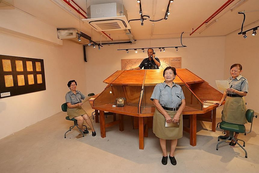 "Former ""Triple Nine girls"" (from left) Evelyn Wong, 71; Lilian Lee, 75; and Lorna Jenner, 70; as well as former police officer George Mathews, 65, at a bunker once known as the Combined Operations Room in Pearl's Hill Terrace in Chinatown. They are i"