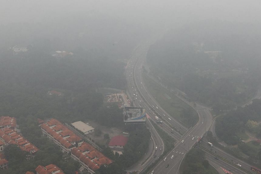 Thick haze obscuring Lake Gardens in Kuala Lumpur, Malaysia, yesterday. The haze from the fires in Indonesia has spread across the country itself, as well as Singapore, Malaysia, Thailand and the Philippines.