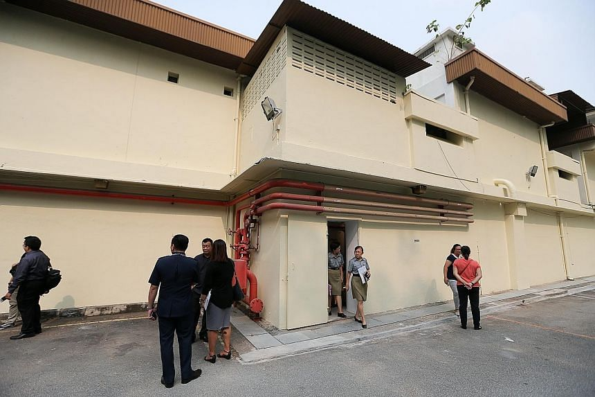 Attendees and veteran police personnel at yesterday's official opening of the Combined Operations Room bunker, which lies inside this building in Pearl's Hill Terrace.