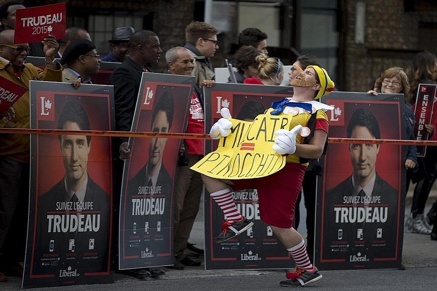 An anti-NDP protester in front of Liberal leader Justin Trudeau's supporters in Quebec this month. The Canadian federal election campaign has been far from dull, with lots of wacky moments for voters to delight in.