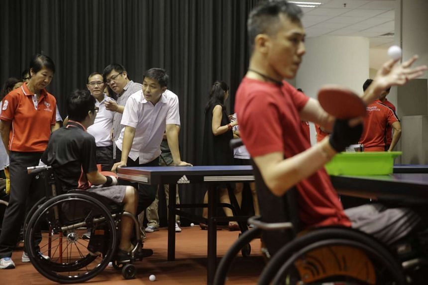 Mr Tan with with para-athletes from the table tennis team at the Singapore Sports Institute on Oct 20, 2015.