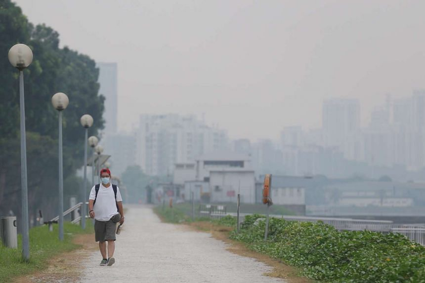 A man wearing a face mask at Pandan Reservoir at 7.30am on Tuesday.