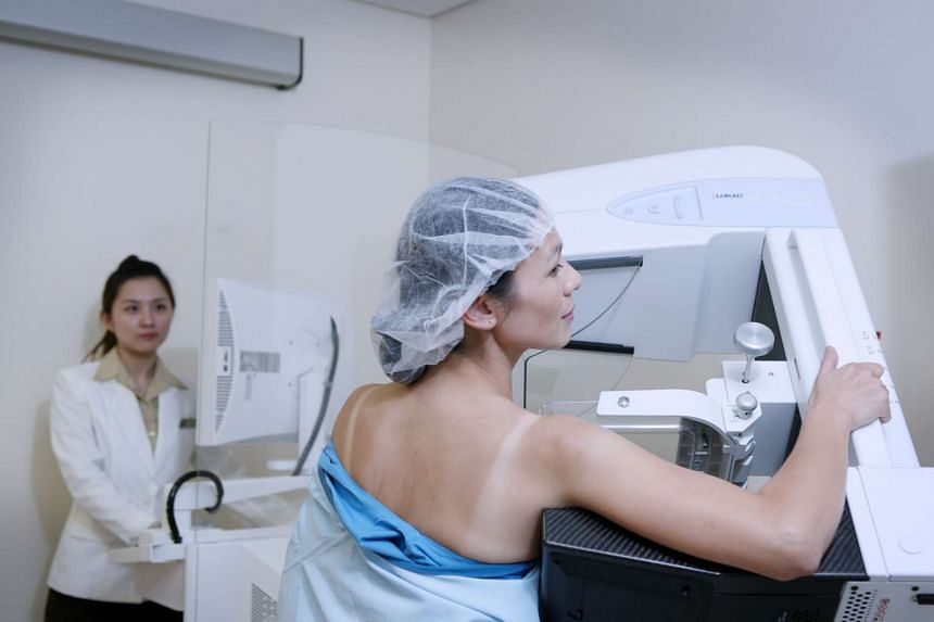 A patient undergoing a mammogram in a file photo.