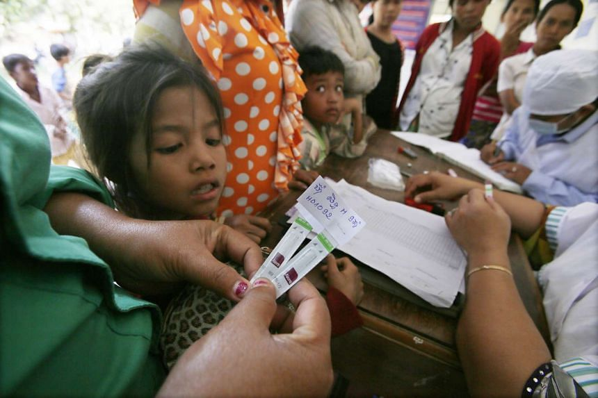 People in Roka village in Cambodia's Battambang province getting screened for HIV in 2014.