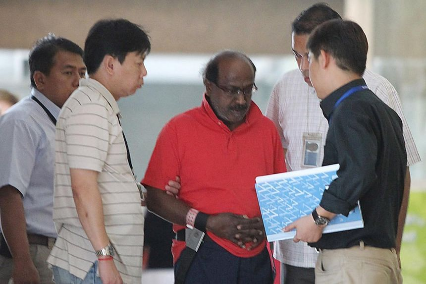Govindasamy Nallaiah (centre), 66, who was  charged with the murder of Madam Low Foong Meng,  was taken back to the scene of the murder on Aug  17, 2011.