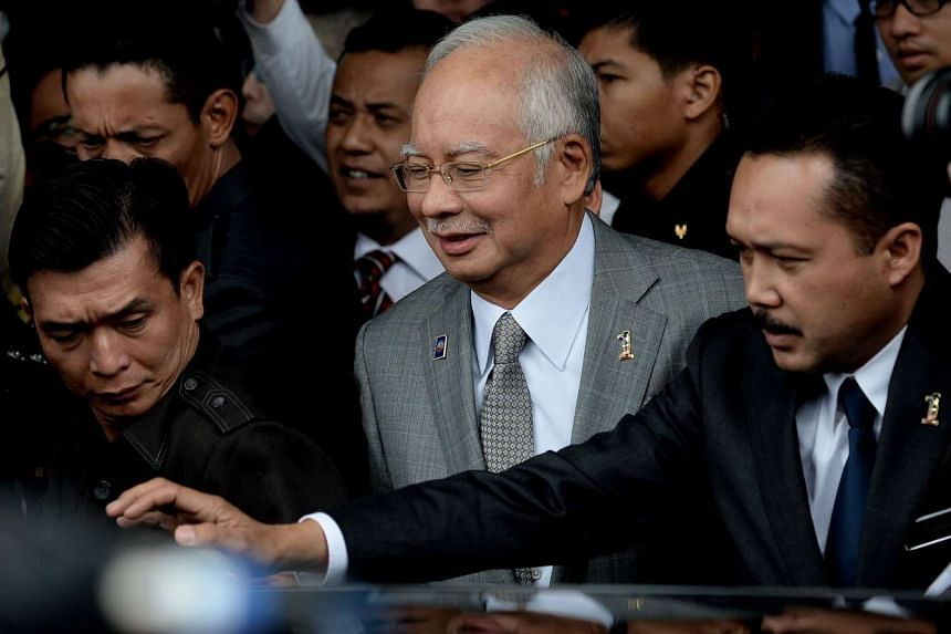 Malaysia's PM Najib Razak (centre) leaving after a parliament session in Kuala Lumpur on Oct 19, 2015.